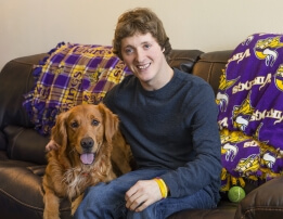 Reese with his golden retriever Goldy